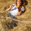 Stock Photo: Girl laying on straw
