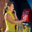 Woman  on the pay phone — Stock Photo
