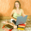 Girl with laptop and books — Stock Photo #3826514