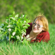 Woman in the spring meadow — Stock Photo