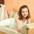 Girl in white lying on sofa — Foto de stock #3827093