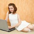 Girl with laptop on sofa — Stock Photo #3827196