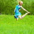 Jumps long-haired girl — Stock Photo