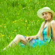 Girl in hat relaxing in grass — Stock Photo #3827533