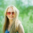 Long-haired girl wearing sunglasses — Stock Photo #3827590