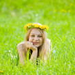Girl in dandelion wreath — Stock Photo #3827710