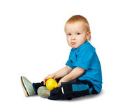 Boy in blue shirt with pear, — Stock Photo