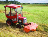 Agrimotor on meadow — Stock Photo