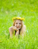 Girl in dandelion wreath — Stock Photo