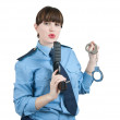 Woman in uniform with gun and manacles — Stock Photo