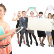 Businesswoman against businessteam holds blank canvas — Stock Photo