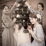 Vintage photo of Family decorating Christmas — Stock Photo