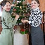 Two women decorating Christmas tree — Stock Photo