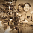 Vintage photo of daughter with mother decorating Christmas tree — Stock Photo #3831625