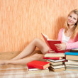 Female student reading books — Stock Photo #3831859