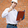 Happy builder with thumbs up — Stock Photo
