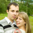 Young couple against park — Stock Photo #3832965
