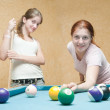 Young women playing billiards — Stock Photo