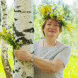 Woman near birch in flowers wreath — Stock Photo