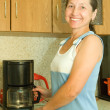 Woman  with coffee machine — Stock Photo