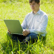 Man with laptop in the meadow — Stock Photo