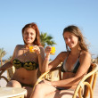 Girls relaxing at resort hotel — Stock Photo