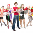 Girls holding coloured christmas gifts over white — Stock Photo