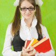 Stock Photo: Schoolgirl in glasses with books