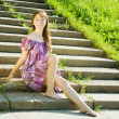 Girl in dress on steps — Stock Photo #3839587