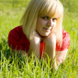 Smiling girl on grass — Stock Photo