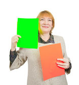 Senior woman holding empty red and green posters. — Stock Photo