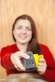 Girl changing channels with clicker at home — Stock Photo