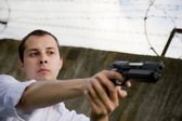 Man aiming a black gun — Stock Photo