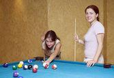 Women playing billiards — Stock Photo