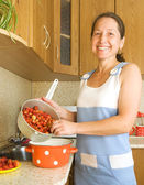 Woman making strawberry jam — Stock Photo