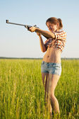 Aiming girl — Stock Photo