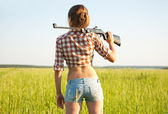 Girl with pneumatic air rifle — Photo
