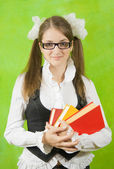 Schoolgirl in glasses with books — Stock Photo