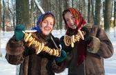Smiling girls with round cracknel — Stock Photo
