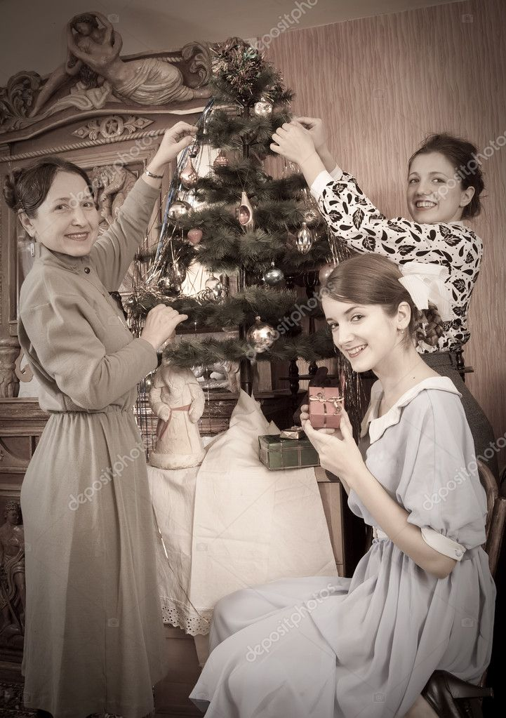 Retro photo of  daughters with mother decorating Christmas tree at home — Stock Photo #3831451