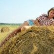 Girl on hay — Stock Photo #3840480