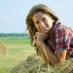 Girl laying hay bail — Stock Photo