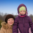 Woman with daughter in winter — Stock Photo