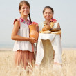 Women with bread at field — Stock Photo #3841235