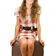 Girl sitting on suitcase — Stock Photo
