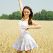Girl  in white at cereals field - Stock Photo
