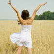 Girl  in white dress at cereals field - Stock Photo