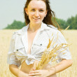 Girl with  wheat ears - Stock Photo