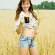 Girl with beer at field — Stock Photo