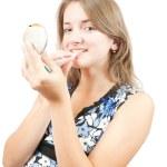 Girl applying lipstick over white — Stock Photo